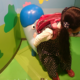 NHKスタジオパークでリアルコッシーに座った長女。ニュースキャスターにもなれます!
